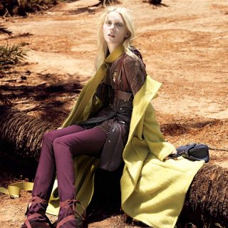 Coat: Weili Zheng; sweater and skirt: Trussardi; belt (work around the neck): Krizia; bordeaux bag with stripes: Solipsi; trousers: Céline; violet leather bag: Trussardi; socks: M Missoni; shoes: Wunderkind