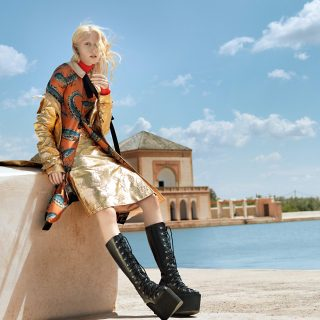 Turtleneck: Krizia; gold trench and skirt: Giuseppe di Morabito; dress: Gucci; boots: Cristiano Burani