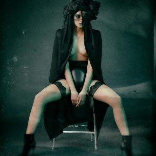 Coat: Céline, Shorts: Kim West, Stockings: Wolford, Boots: Roger Vivier