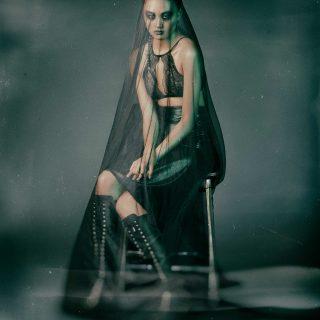 Bra: Wolford, Skirt: Bottega Veneta, Boots: Hermès
