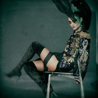 Jacket: Dolce & Gabbana, Skirt: Céline, Stockings: Wolford, Boots: Jimmy Choo