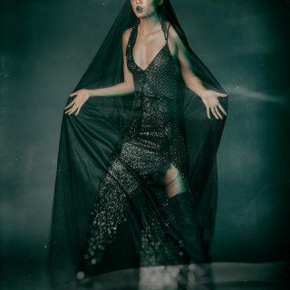 Dress: Versace, Boots: Christian Dior