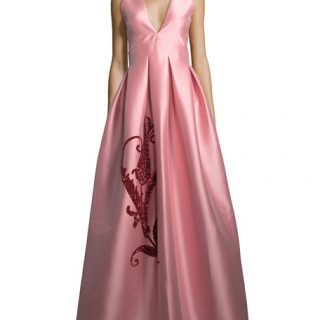 Whether it's for a pre-Christmas dinner party or New Year's Eve, Sachin & Babi's perfectly proportioned pink gown is a masterclass in modern elegance. The V front invites you to add a sparkling necklace, and we say match your manicure to the stunning crimson embroidery that decorates the skirt. Sachin & Babi gown, available at Neiman Marcus.