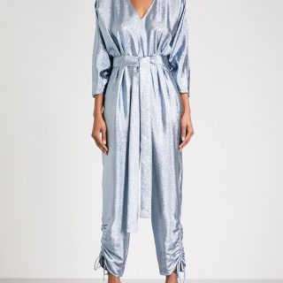 Take your cue from the New Year's Eve disco ball and set your style to stun in this shimmering silver jumpsuit. Cinched at the waist and ankles, it'll bring a dash of 1970s sophistication to dressed-up events. Stella McCartney jumpsuit, available at Saks Fifth avenue.