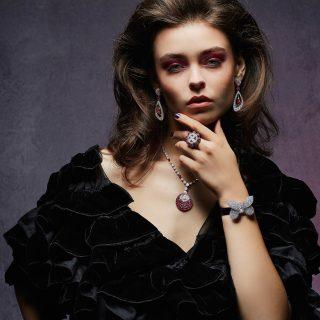 Outfit: Giorgio Armani. All jewellery: Graff. Multishape ruby and diamond earrings, multishape ruby and diamond ring, multishape ruby and diamond necklace, princess butterfly diamond watch.