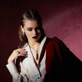Outfit: Giorgio Armani. All jewellery: Cartier. Earrings in platinum with ruby and diamonds; Necklace in white gold with ruby. Mother-of-pearl, emerald and diamonds; Ring in platinum with ruby, mother-of-pearl, emerald and diamonds.