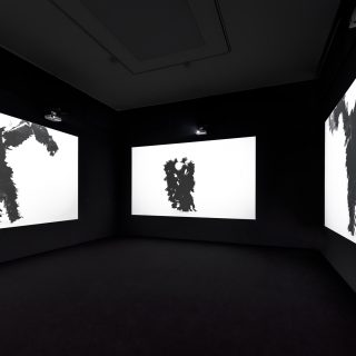 Bae Young-whan (South Korea), Abstract Verb – Can you remember?, 2016 — A contemporary take on traditional rituals, South Korean artist Bae Young-whan's four-channel video, titled Abstract Verb – Can you remember? (2016), features a feather-clad performer dancing and gyrating to a pounding, percussive beat – an interpretation of shamanistic dance rituals of various communities for an MTV age.