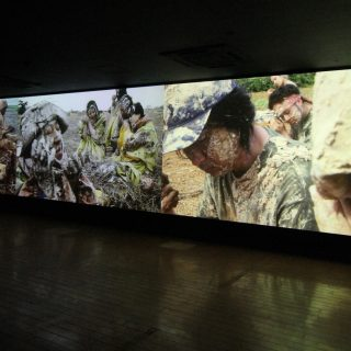 Chikako Yamashiro (Japan), Mud man, 2016 — Japanese artist Chikako Yamashiro's Mud man (2016) addresses issues of cultural identity, geopolitics and the persistence of historical memory. Through a video shot in Okinawa and Jeju Island, the work features a lyrical and enigmatic narrative of a community of people awakened to poems of their history, nature, and other similar communities.