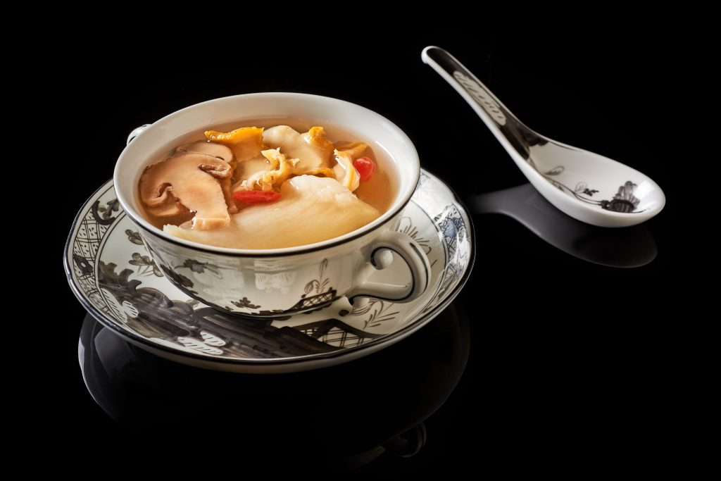 Double-boiled chicken and sea whelk soup with fish maw and matsutake mushroom