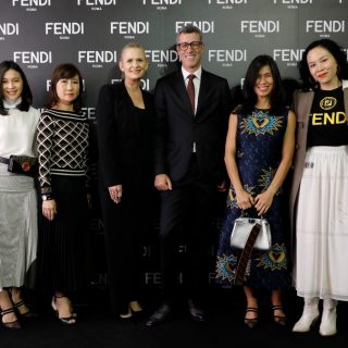 Fendi management team; Andrea Crippa (3rd from right), Clara Goh (2nd from right), Florance Yip (far right) and Pansachol Thavornvong (far left) with Siam Paragon Development Co.,Ltd. management team; Caroline Murphy (3rd from left) and Araya Chittaropas  (2nd from left)