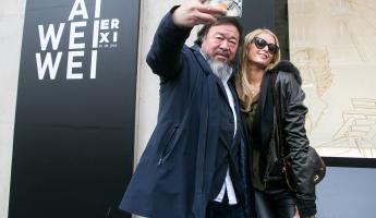 Ai Wei Wei takes a selfie with Paris Hilton, which he later shared on Instagram. Photo: Getty Images / Marc Piasecki
