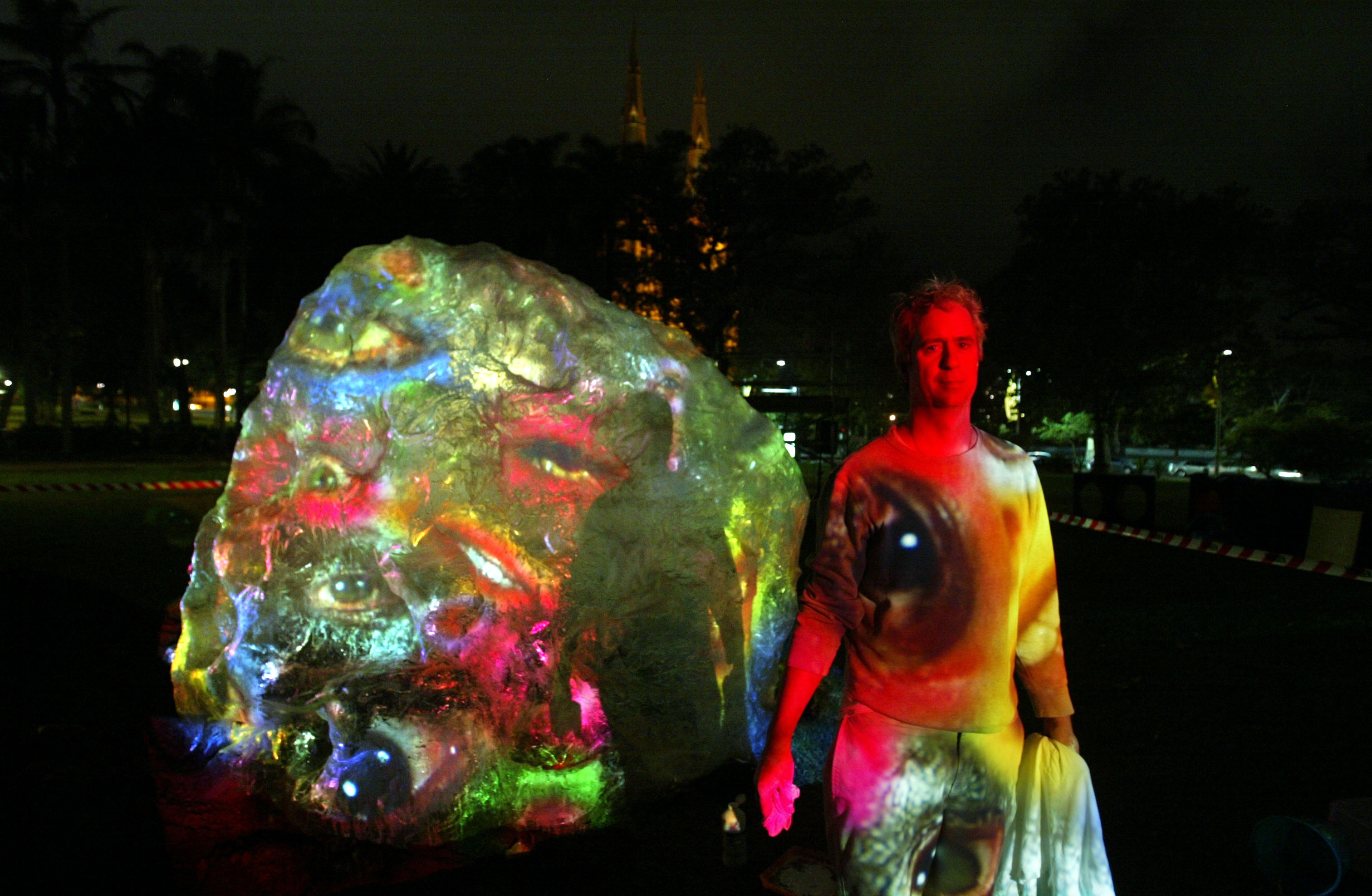Tony Oursler in front of his installation Blue Invasion in Sydney