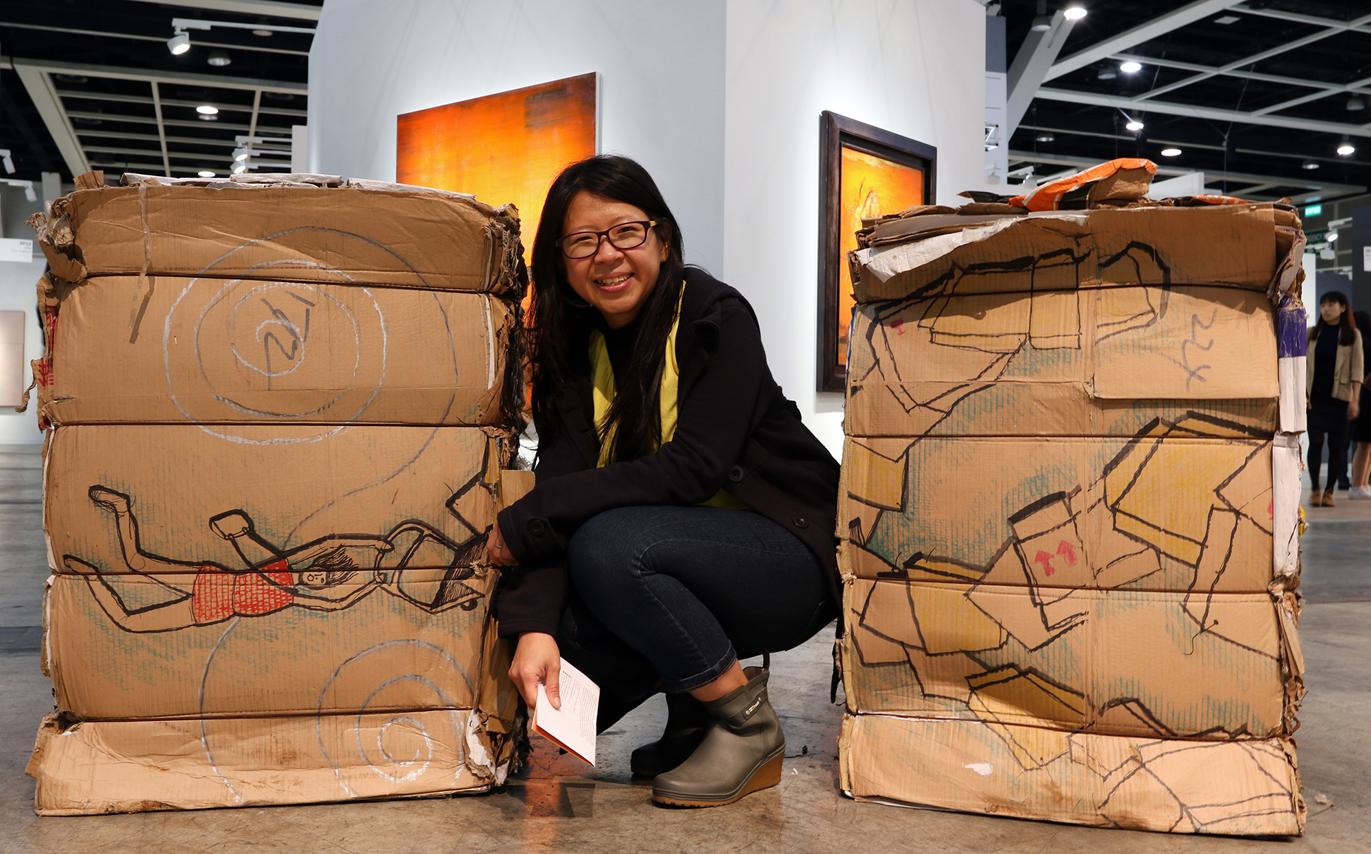 Tintin Wulia poses with Five Tonnes of Homes and Other Understories. Photo: Evangeline SM Lam