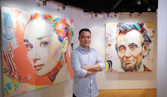 Ren Zhenyu, with some of his works on show at Art Futures Gallery