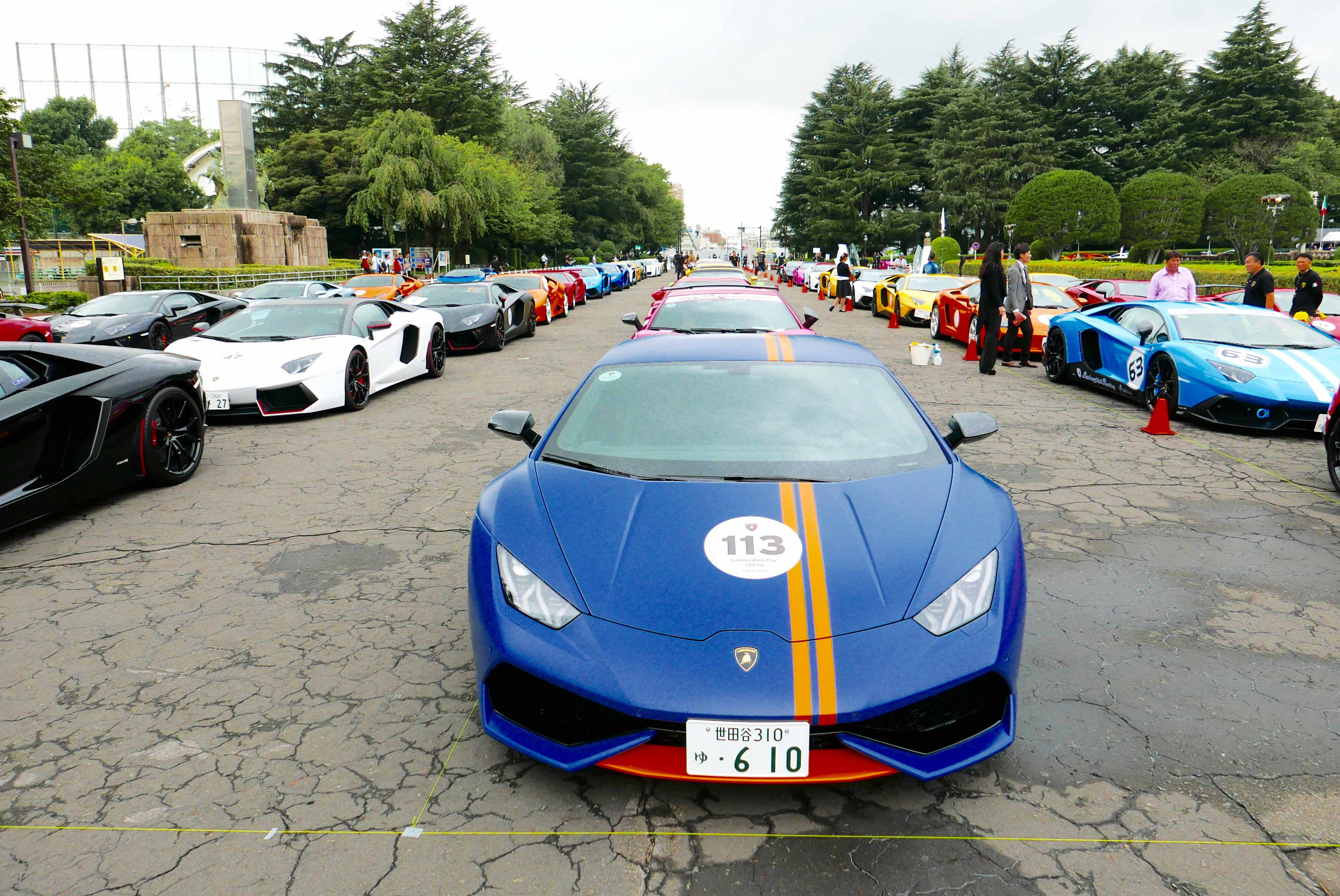 Lamborghinis prepare for a parade drive through Tokyo
