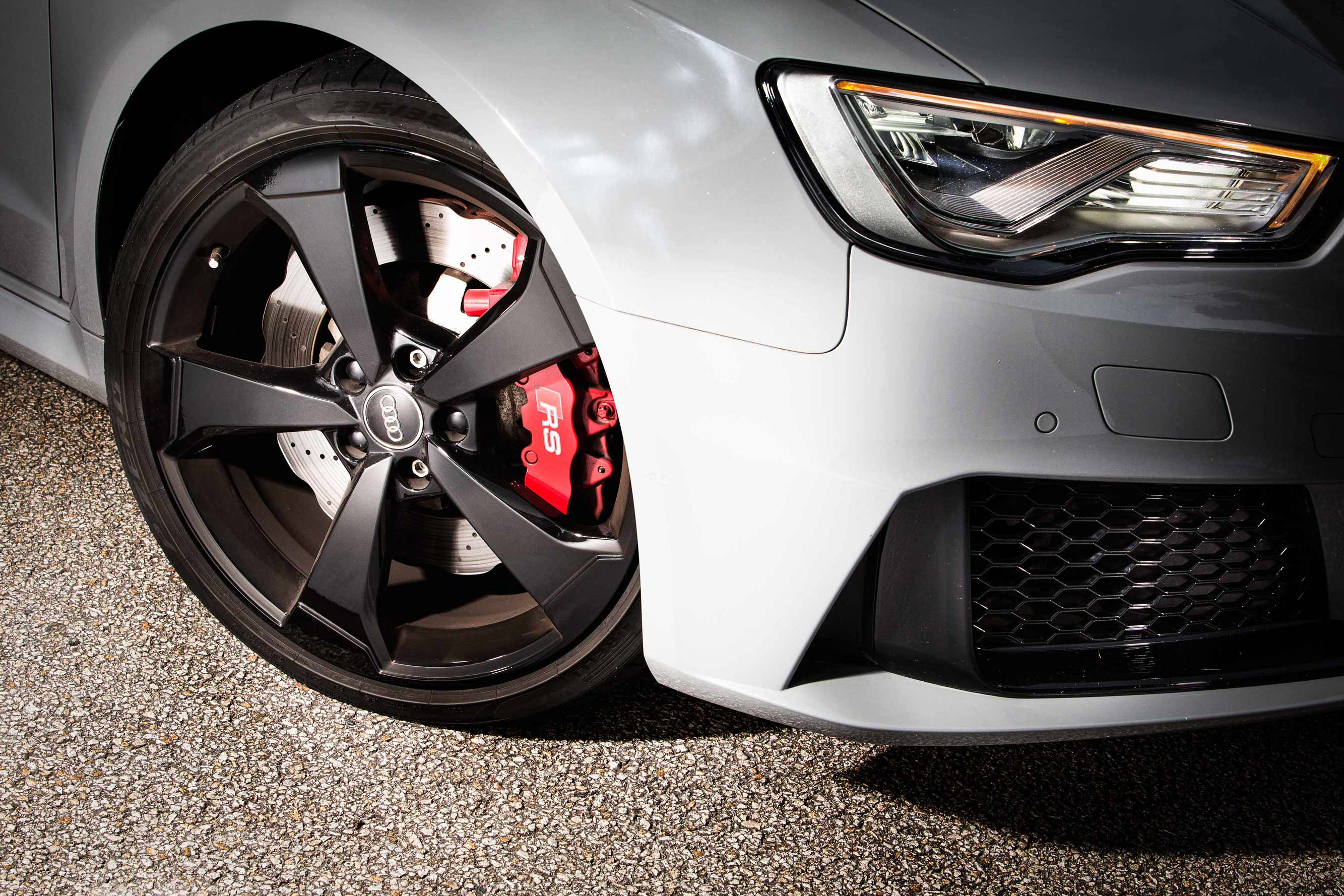 Drilled Wave-Front Disc and Bright-Red Calliper Peep Through 19-Inch, Five-Spoke Alloy Wheel