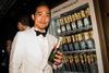 Alex Lam enjoying the delights of the Moët & Chandon vending machine at amfAR Hong Kong