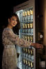 Antonia Li samples a Mini Moët bottle from the Moët & Chandon vending machine at amfAR Hong Kong