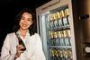 Myolie Wu strikes a pose next to the inimitable Moët & Chandon vending machine at amfAR Gala Hong Kong