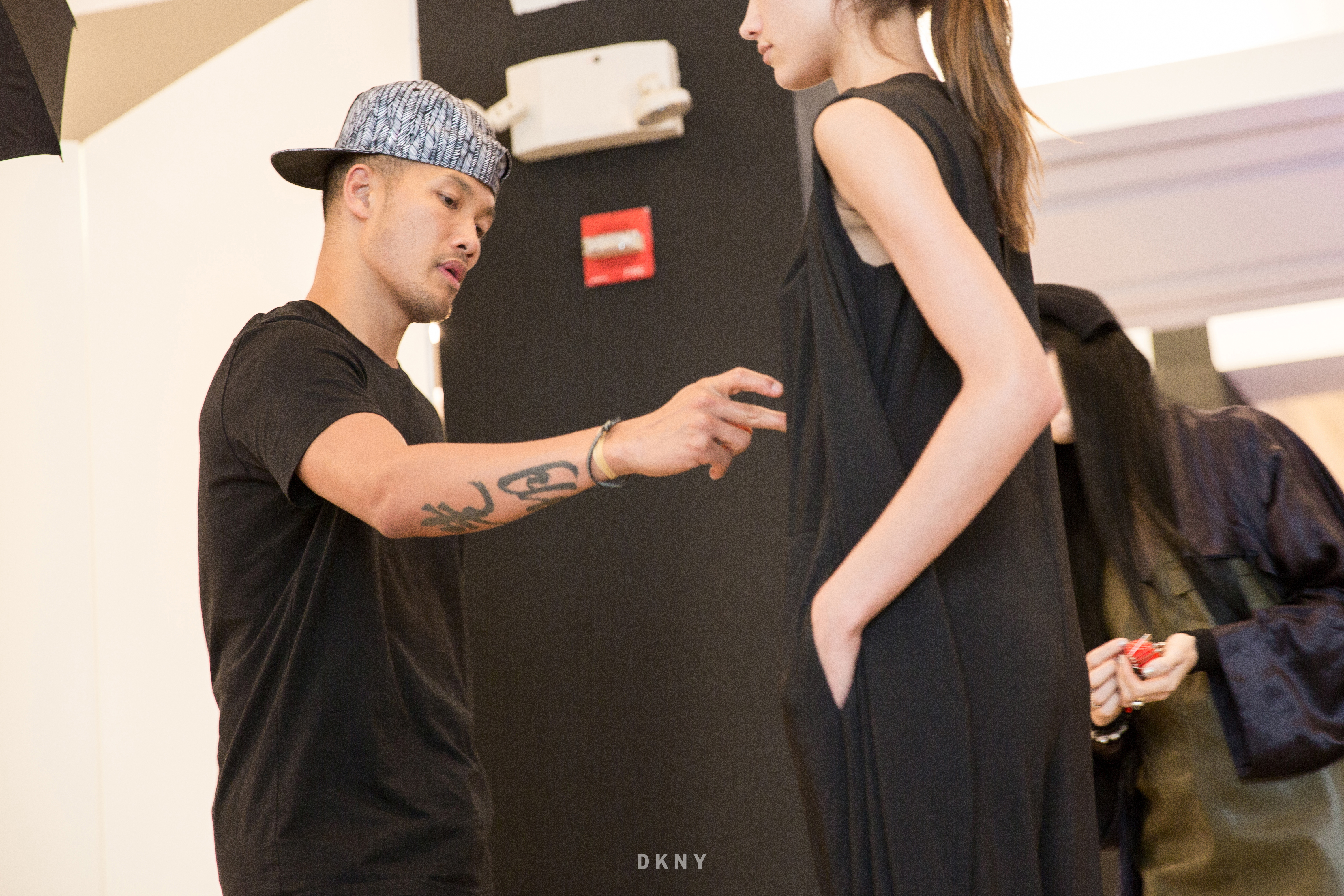 Dao-Yi Chow with a model in the studio