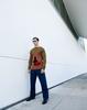 Jumper, trousers and shoes: Prada. Sunglasses: Carrera