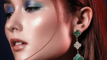 Earring: Van Cleef & Arpel. Top: Escada
