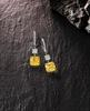 The sparkling Forevermark Fancy Intense yellow diamond earrings, weighing more than five carats
