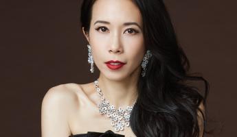 Dress: Lanvin. Earrings, ring, bracelet and necklace: Bulgari
