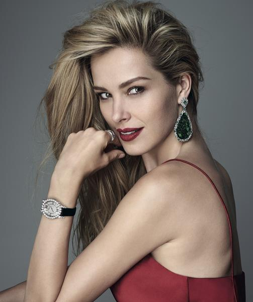 Earrings, ring and watch: Chopard. Dress: DKNY
