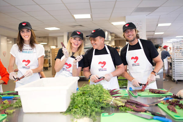 Hilary Rhoda, Blaine Trump, Michael Kors and Lance Le Pere volunteering at God's Love We Deliver