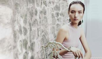Dress: Bottega Veneta. Bracelet and earrings: Van Cleef & Arpels