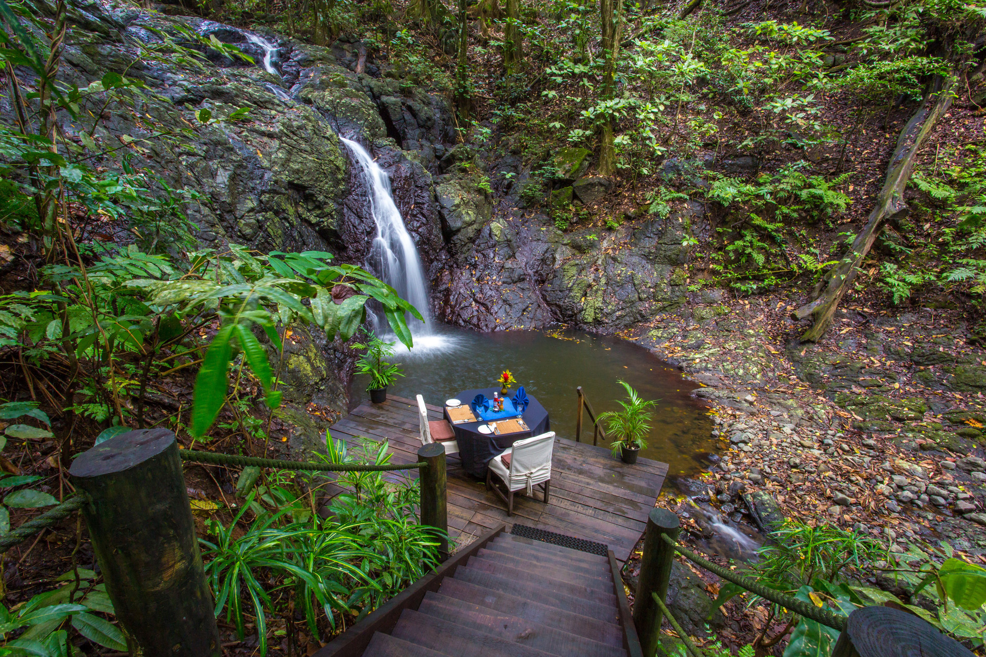 Dining by a waterfall at Namale Fiji