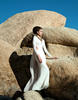 DRESS: MARIA LUCIA HOHAN; WHITE CAPE: ROBERT DANES; NECKLACE: PLUMA ITALIA; SHOES: DANIELE MICHETTI