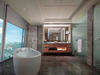A BATHROOM WITH CITY VIEW