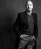MICHAEL KEATON; COAT: SAINT LAURENT BY HEDI SLIMANE; SHIRT: SALVATORE FERRAGAMO; JUMPER: LANVIN; TROUSERS: GIVENCHY BY RICCARDO TISCI