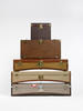 A STACK OF VINTAGE MOYNAT AUTOMOBILE TRUNKS