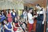 Prestige's fashion director Terence Lee accessorises a model