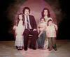 Kris and Elizabeth Wiluan with their children