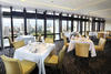 Breathtaking views of the skyline are visible from the restaurant's dining rooms