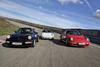 A trio of 911s at the Weissach test track. From left: 964 Coupe, 911 Clubsport, 993 Turbo Coupe