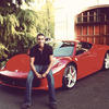 A young man shows off his brand new Ferrari