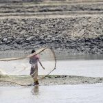 A-fisherman-casting-his-net-into-the-river-Getty-Images1