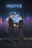 2012 winner Min-Liang Tan receives his award from DBS's Carol Hung