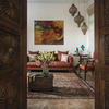 Three-centuries-old doors, salvaged from an Indian Haveli, open to a house full of multicultural charm