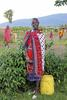 A young Maasai girl poses for the camera
