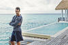 David Gandy in a dark navy mist garment dyed cotton sweater and dark navy crinkle cotton ramie shorts, both from Bottega Veneta