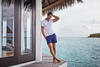David Gandy in a Digby white polo shirt with front pocket and Spring navy swim shorts, both from Orlebar Brown