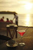 Enjoy a cocktail at Thila while enjoying the sunset