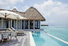 The terrace and infinity pool of an overwater villa