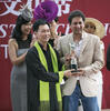 Melvin Ang presents the CECF Singapore Prestige Classic trophy to Kiwi Karma owner Nanik Ramachandani